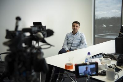 A client being filmed for a corporate video
