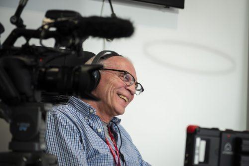 Ian Sandall filming a video interview